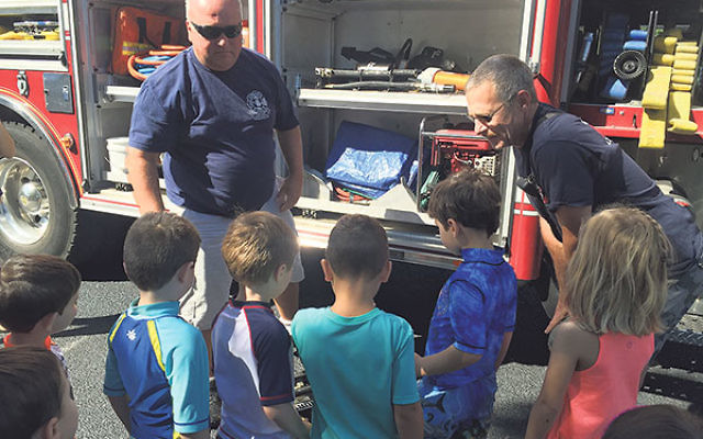 Kids meet the people who help keep them safe at Temple Shaari Emeth in Manalapan.