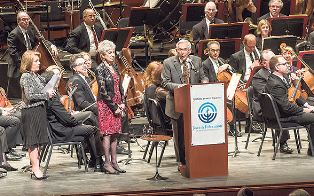 Concert adviser and benefactor Edward Zinbarg addresses the audience at the NJSO/UJA Campaign concert, accompanied by his wife Barbara, middle, and UJA Campaign chair Maxine B. Murnick.