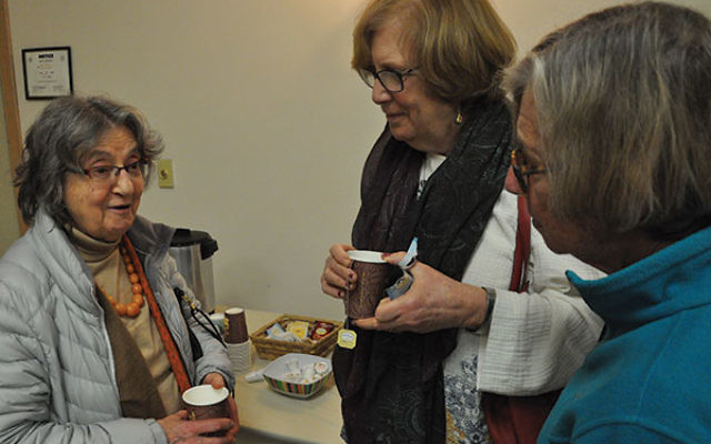 Ecuadorian native Anna Rosa Kohn of Princeton, left, speaks with attendees at the screening of An Unknown Country, Glenda Mendelsohn of Yardley (center) and Janet Moshe of Jerusalem.