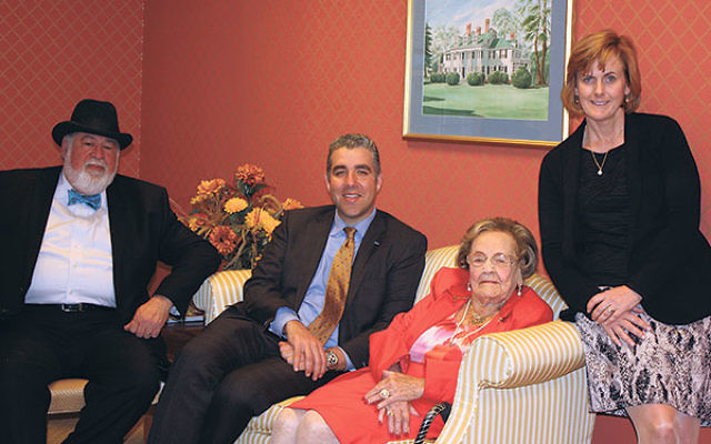 Thanking Ruth Hyman, seated, from the VNA Health Group are, from left, Rabbi Nathan Langer, president and CEO Dr. Steven Landers, and chief philanthropy officer Bridget Murphy.