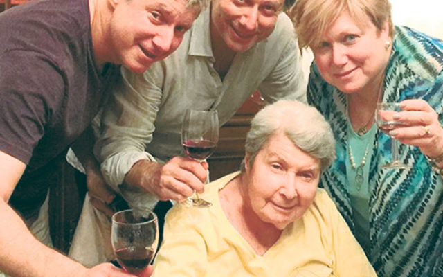 Rabbi Shira Stern and her brothers, Michael, left, and David, with their mother, Vera, 10 days before her death.