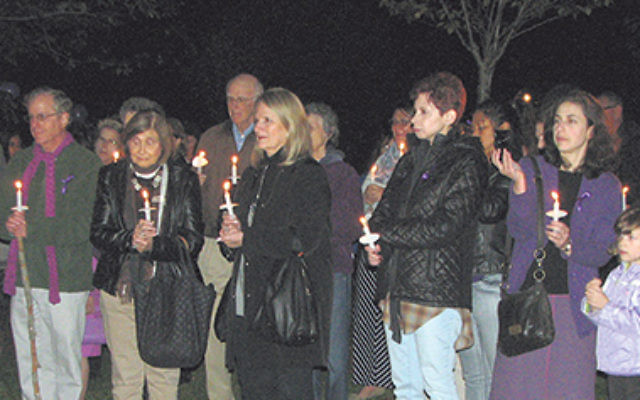 About 70 people attended the vigil at the Livingston Oval to mark Domestic Violence Awareness Month.