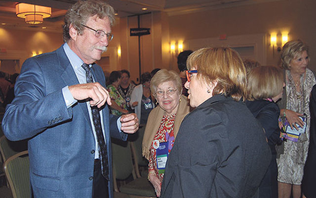 Keynote speaker Rabbi Gordon Tucker talks with participants at the convention of the Women's League for Conservative Judaism.