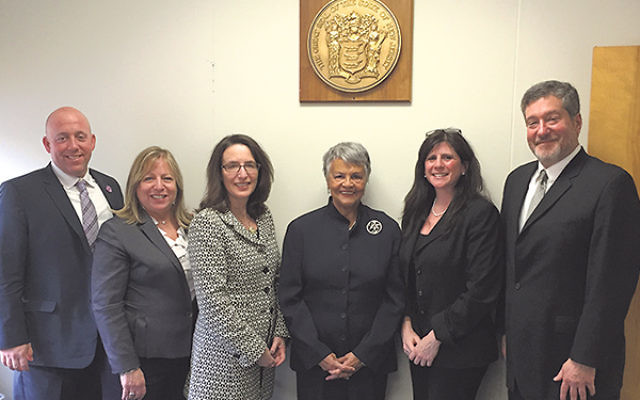With Rep. Bonnie Watson Coleman, fourth from left, are, from left, Keith Krivitzky, Amy Mallet, Leslie Dannin Rosenthal, Melanie Roth Gorelick, and Martin Raffel.