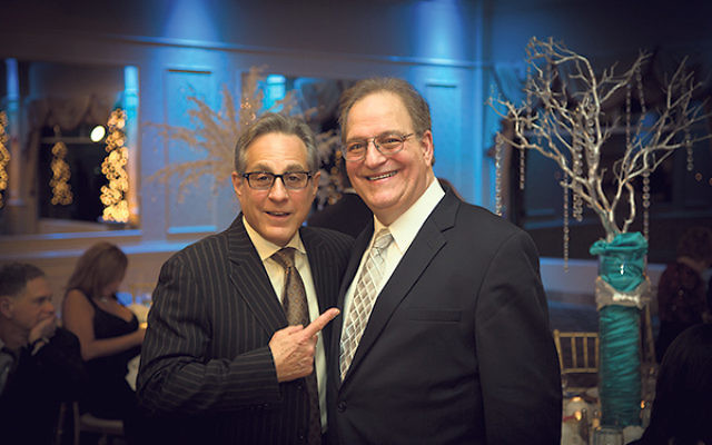 Rabbi Donald Weber, right, with fellow honoree, Rock and Roll Hall of Fame drummer Max Weinberg, at the Feb. 28 Temple Rodeph Torah gala at Battleground Country Club in Manalapan. Weinberg, who grew up in New Jersey and now lives in Monmouth County, was s