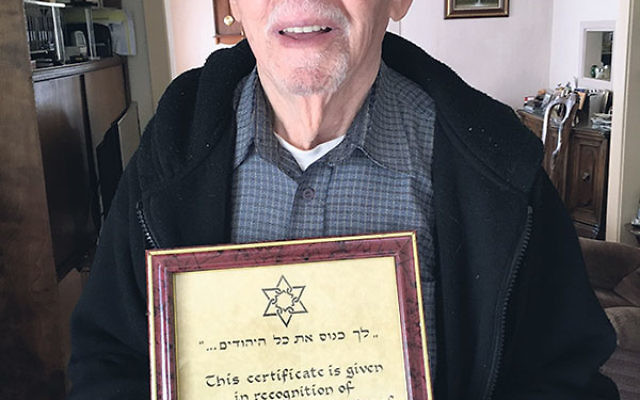 Joseph Werk displays the certificate recognizing his service as a veteran Sar-El volunteer.