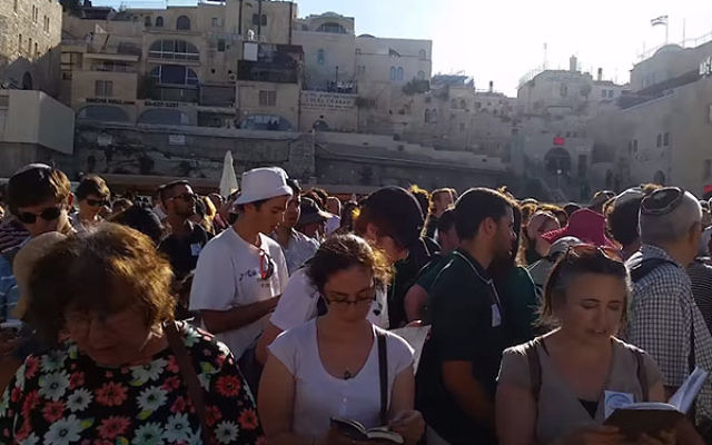 Conservative and Reform Jewish activists taking part in an egalitarian prayer service at the Western Wall plaza, June 16, 2016. (Screenshot from YouTube)