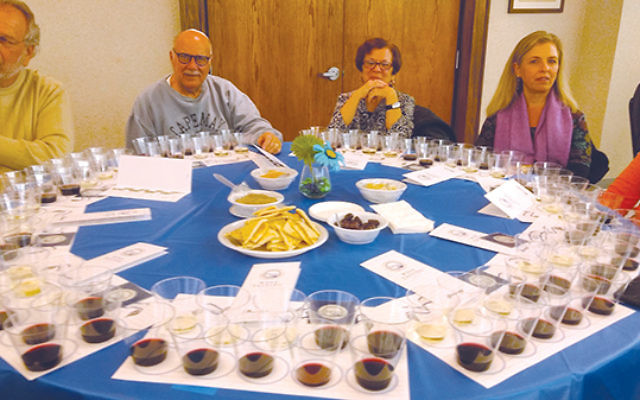 Those attending Temple Beth El's program sampled 10 wines from whites to reds of varying complexities and flavors. Photos by Debra Rubin