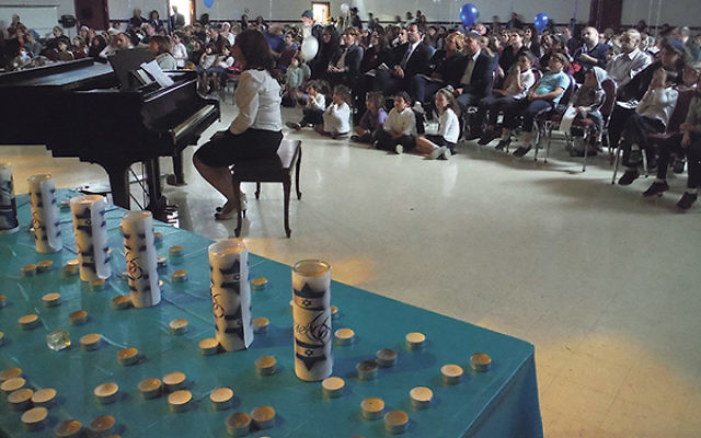 Candles commemorating Israel's fallen await lighting at the Union Y's Yom Hazikaron and Yom Ha'atzmaut gathering.