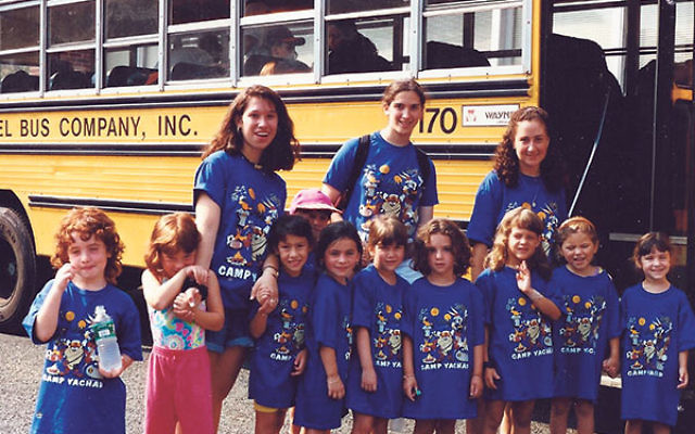 Door-to-door bus service did not begin until 1997; in 1994 these campers were picked up from group stops.
