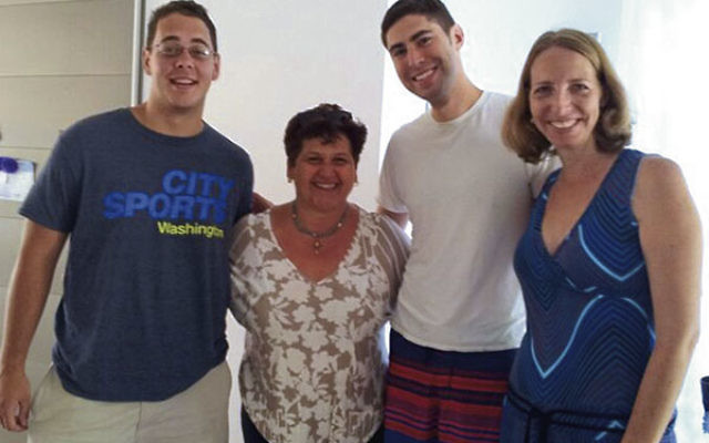 Alex Ratner, second from right, visits Rishon Letzion with fellow Whiffenpoof singer Ben Lewis, host Joyce Edri, and Michal Zur, right, director of Israel connections at the Greater MetroWest federation's office in Jerusalem.