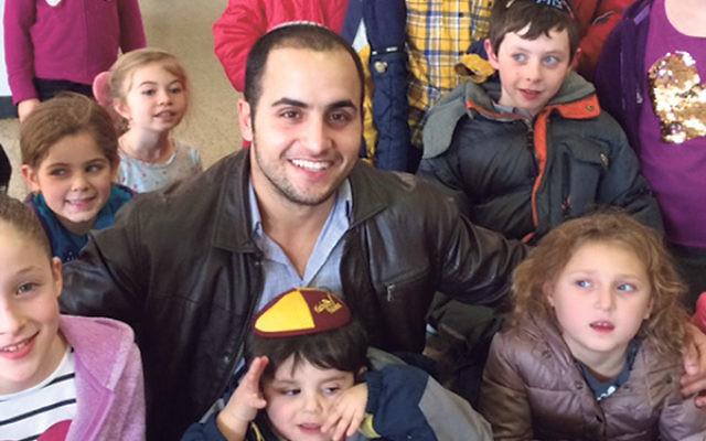 Community shaliah Maor Tiri with children at the Union Y.