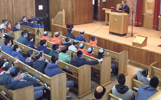 Uri Yifrach, father of the slain teen Eyal Yifrach, addresses students at the Jewish Educational Center's Rav Teitz Mesivta Academy.