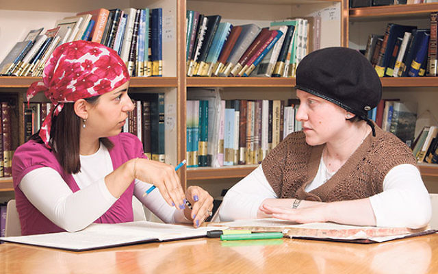 Nechama Price, right, studies with another yoetzet Halacha at Nishmat, the women's Torah study center in Jerusalem.