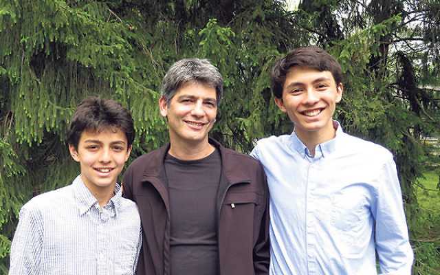 Gideon Fruchter, with sons Shai, left, and Itai, said he learned the value of young people chatting with seniors from the brothers' long-distance talks with their grandmother.
