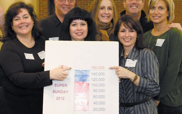 Andy Frank, second from left, celebrated with other leaders of the Jewish Federation of Princeton Mercer Bucks at its Super Sunday fundraiser in 2011. The federation announced this week that he is stepping down as executive director.