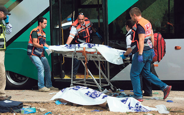 Israeli rescue workers respond to a deadly terror attack aboard a Jerusalem bus, Oct. 13, 2015.