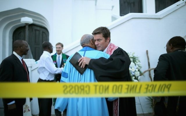 The Rev. John Hage, right, embracing the Rev. Sidney Davis outside the historic Emanuel African Methodist Episcopal Church in Charleston, S.C., June 18, 2015. (Chip Somodevilla/Getty Images)