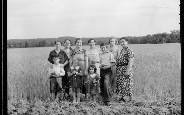 """Dorothea Lange visited the Hightstown, NJ farming cooperative in June 1936 on assignment from the Farm Security Administration. Jewish homesteaders worked on the cooperative farm. According to the caption, """"This group represents wives and children o"""