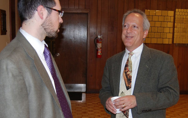 Old friends Rabbi Joshua Hess, left, and Aryeh Green talk before Green's presentation at Congregation Anshe Chesed in Linden.