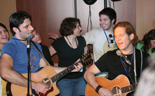 """Jewish rock musicians Rick Recht, center, and Sheldon Low, left, lead a """"boot camp"""" for songleaders in St. Louis in May, like the one they will be doing in October in Scotch Plains and Summit."""