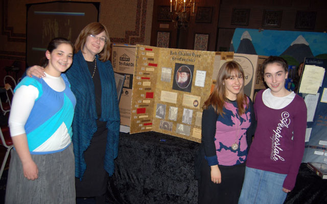 Bruriah principal Marcy Stern, second from left, explores the Great Sages exhibit with 10th-graders Shoshana Agishtein, Aviva Cantor, and Esther Hirsch. Photo by Elaine Durbach