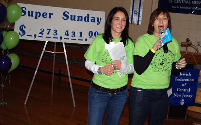 Lisa Israel and Ellen Zimmerman, cochairs of Super Sunday 2011, announce an increase in the midday pledge total.