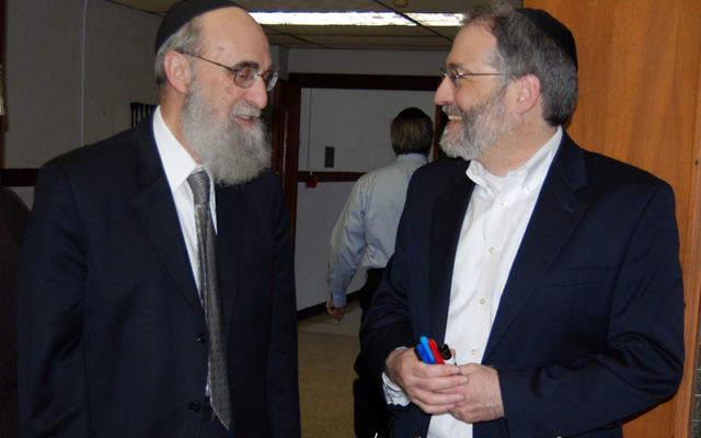 Gregg Rothstein, right, sponsor of the Day of Learning, welcomes Rabbi Elazar Teitz, who opened the program. Photos by Elaine Durbach