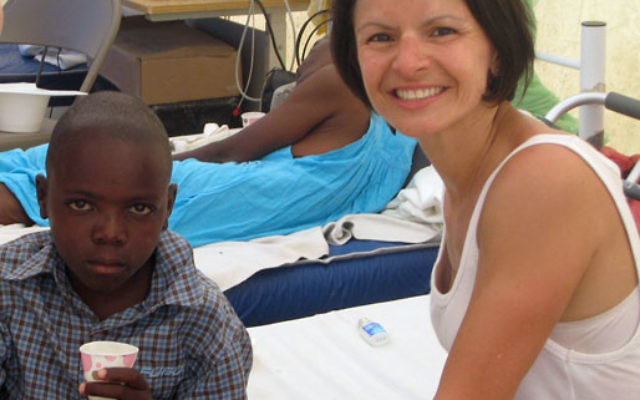 Dr. Alexis Halpern with a young patient at the makeshift hospital where she worked as a volunteer in Haiti.