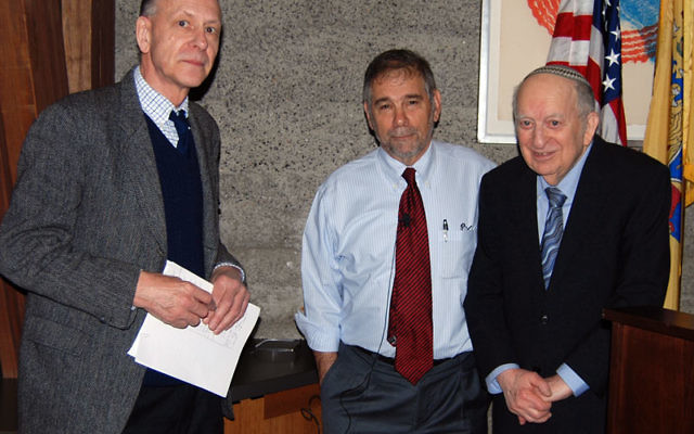 During a break in his Kean University seminar on the Holocaust, Michael Berenbaum, center, talks with Dr. Keith Nunes, and Dr. Joseph Preil. Photo by Elaine Durbach