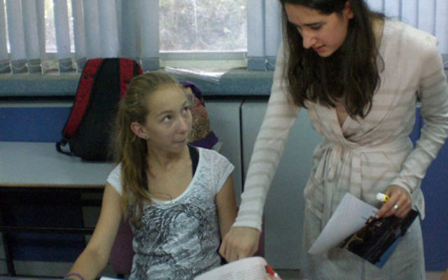 Eliana Sohn, right, a student from Elizabeth, teaches English to a camper at the summer camp in Arad run by Yeshiva University through its Counterpoint Israel program. Photo courtesy Yeshiva University