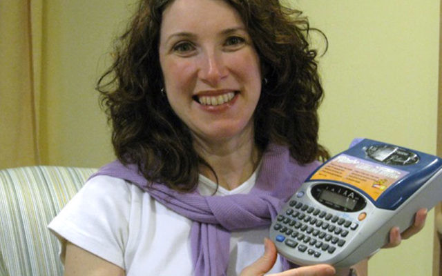 Stacey Agin Murray, showing off her one of her favorite organizational tools, a label-maker, will speak at the Queen Esther Tea at the Union Y on Sunday.