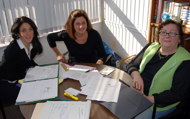 The chairs of the Second Annual Supermarket Sweep Foodraiser, from left, Lisa Israel, Elyse Deutsch, and Janice Weinberg, meet to plan the March 14 event.