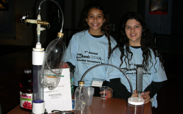 JEC sixth-graders Neshama Fournier, left, and Sarah Brown show the fizz invention that won them second place in the Liberty Science/Telebrands invention competition. Photos courtesy JEC