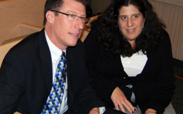 Author and academic Rabbi Dr. Daniel Gordis speaks with Central federation campaign leader Julie Singer before addressing an audience at Congregation Beth Israel.