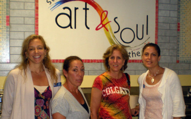 Proudly showing off the JCC's new art room are some of the people responsible for the programs that will take place there, from left, Amy Warsh, Leslie Vogel, Debbie Livingston, and Sheri Finver. Photos by Elaine Durbach