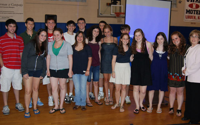 Joining participants in the JCC's Teen Action Service Corps at their concluding dinner are guest speaker JoyAnn Brand, far right, and JCC teen services director Mallory Saks, second from right. Photos by Elaine Durbach