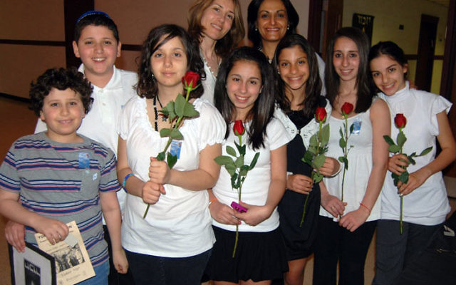 P2K outreach organizers are hoping for more events like last year's Yom Hazikaron commemoration, organized with help from Israelis like Gila Dishy and Anat Torovesky, back row, left and right.