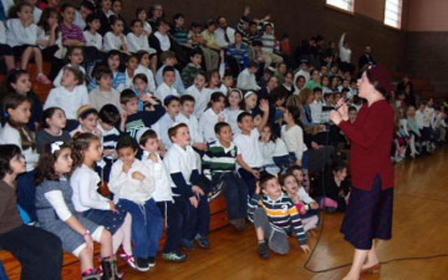 Author Leah Braunstein Levy tells children at the Jewish Educational Center about the challenges and rewards of the writing life.