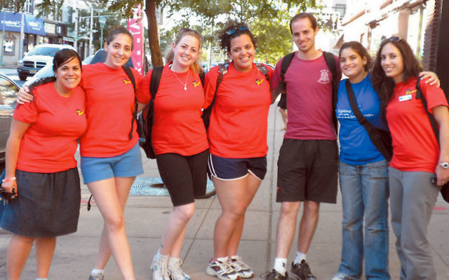 Israeli emissary Yisca Shalev, left, lines up with five of her fellow Israelis, all working this summer at the Y and JCC camps, from left, Naama Shiloah, Shir Altshuler, Noa Cohen, Izik Daniel, Liraz Gross, and Shani Bitkover.