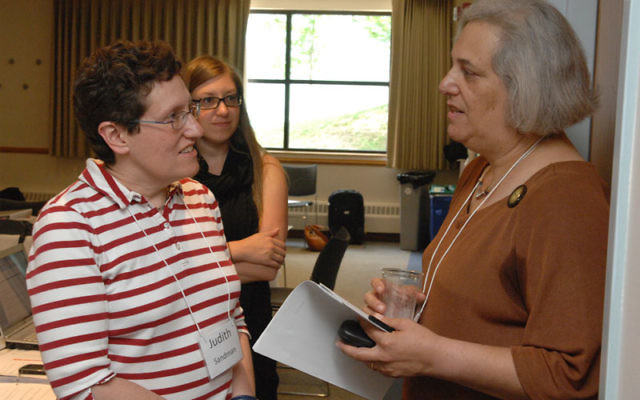 At the Jewish Women's Archive Institute for Educators in mid-July, Judy Sandman of Temple Emanu-El in Westfield, left, talks with oral historian Dr. Jayne Guberman after a workshop on how to conduct oral history interviews. Photo by Gus Freedman