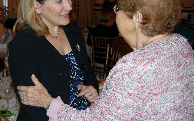 Main Event keynote speaker Sue Fishkoff, left, is greeted by a family friend, Elinor Goldman, at the Women's Campaign's 2010 gala. Photos by Elaine Durbach