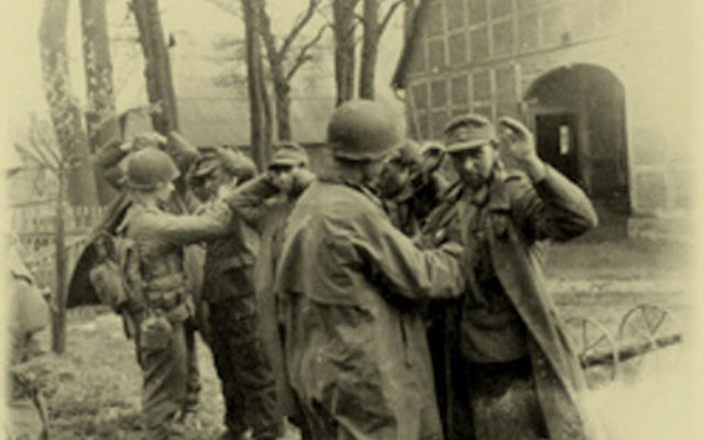 New Jersey Jewish veteran Harry Lorch provided this picture for the documentary About Face, showing Jewish soldiers taking German prisoners, during World War II. Photo courtesy Harry Lorch, from AboutFacefilm.com