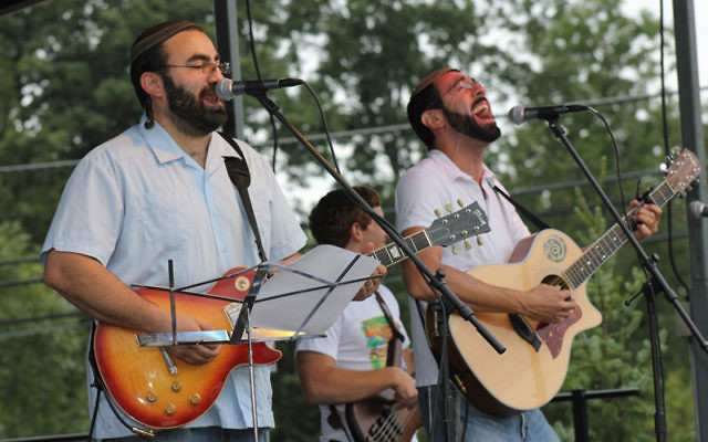 Braving the elements, members of the band Pey Dalid entertain the festival crowd at the Chabad Center in Basking Ridge. Photos courtesy Chabad Jewish Center of Basking Ridge