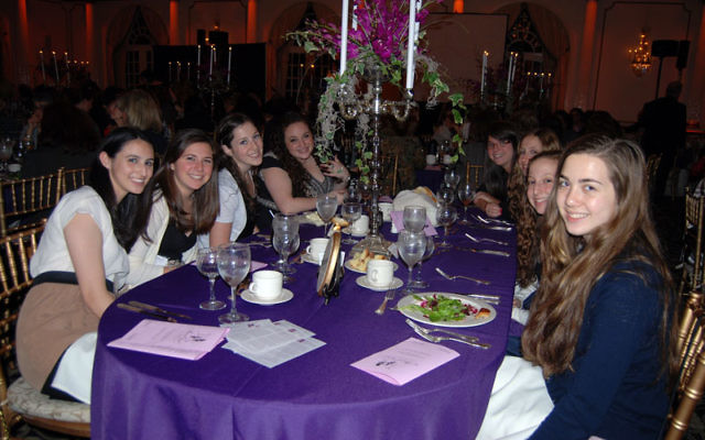 Enjoying the Main Event are teen attendees, from left, Britty Cohen, Cara Levinson, Haley Lindenberg, Allyson Rome, Julie Deutsch, Nicole Rosenberg, Maddie Rosenberg, and Dara Levy. Photos by Elaine Durbach