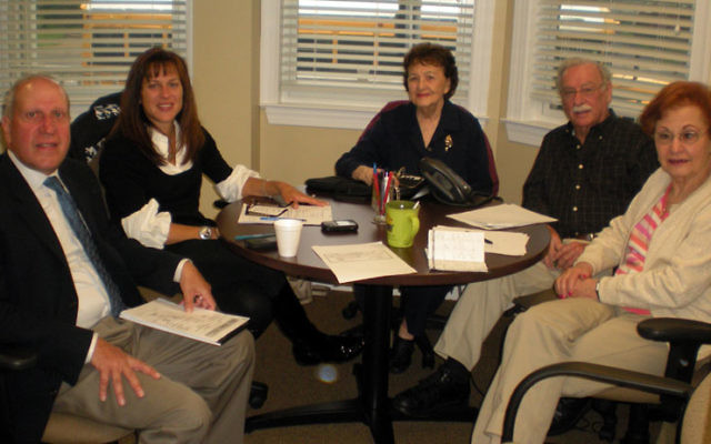 Incoming JFS president Jennifer Pollak, second from left, chairs a planning meeting with, from left, executive director Tom Beck and longtime JFS volunteers Ruth Bilenker, Abe Suckno, and Bernice Fleischmann. Photos by Elaine Durbach