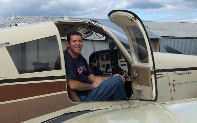 "Ready for takeoff: Matthew Axelrod, cantor, pilot, flight instructor, and a member of Jews in Aviation, said he now sees that flying is ""a fine complement to my kavana."" Photos by Johanna Ginsberg"