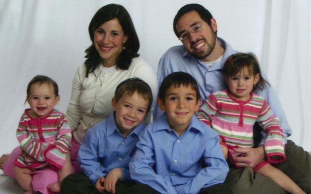 Rabbi Joshua Hess will be near his wife Naava, and their children (seen here in a 2009 portrait) as they vacation in Israel this summer, when he takes up a position as rabbinical leader of a Yeshiva University-run summer camp in Arad, Israel.