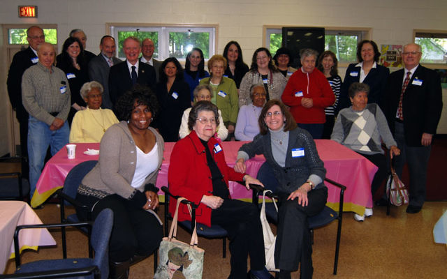 Rep. Leonard Lance, standing, sixth from left, met with JFS staffers, community leaders, and senior citizens at the Westfield Community Center and expressed his support for the JFS LINKS program that provides seniors with support services. Photo by Elaine
