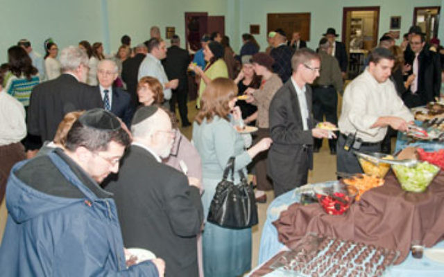 Participants at the Nov. 1 gala for Hatzalah of Union County mingle over desserts.